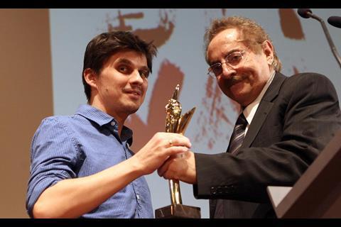 Golden Alexander Winner Bodgan George Apertri (Outbound) with TIFF's new director Dimitri Eipides.